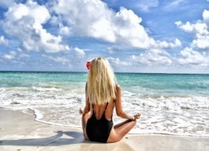 meditating blonde on beach